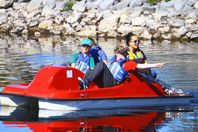 The Guthrie family and friends enjoy a paddleboat ride on Lake Elmer Thomas Oct. 26, 2019, during Fort Sill's FMWR Fall Festival. All amenities were free during festivities, which ran from noon to 4 p.m.