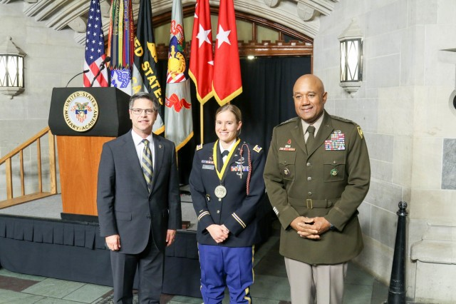 Lt. Gen. Darryl A. Williams, superintendent of the U.S. Military Academy, and Todd Browne, West Point Association of Graduates president, present the 2019 Nininger Award to Capt. Lindsay Gordon Heisler, USMA Class of 2012, Thursday, Oct. 25, 2019. Heisler received the award for her actions on Dec. 5, 2015 when she was deployed in Afghanistan. (U.S. Army photo by Brandon O'Connor)