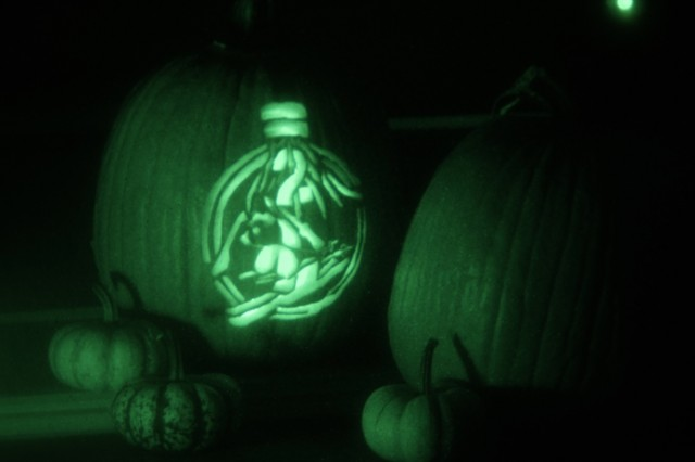 """The """"Pando Commando"""" glows in night vision from a festive jack-o'-lantern display, October 27, 2019, at Fort Drum, New York. The skiing panda, or """"Pando Commando,"""" has recently gained popularity across the """"Commando"""" brigade, or 2nd Brigade Combat Team, 10th Mountain Division (LI). The informal insignia originates from the Pando Valley near Camp Hale, Colorado, where the 10th Light Division (Alpine) was activated in 1943. When the unit was re-designated as the 10th Mountain Division (LI) in 1944, the Pando Commando remained as an unofficial logo and a piece of the division's history. (U.S. Army photo illustration by Staff Sgt. Paige Behringer)"""