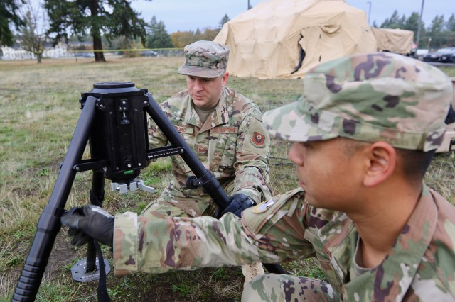 The U.S. Air Force 22nd Special Tactics Squadron's Tech. Sgt. Jacob M. Sinovic and Sgt. Vuthy Var erect an antenna mast during exercise Noble Skywave at Joint Base Lewis-McChord, Washington, Oct. 23, 2019. A team of 7th Infantry Division Soldiers, 1st Group Special Operations Forces, and airmen from the 22nd Special Tactics Squadron represented JBLM in the competition, testing their abilities against 146 military signal teams from around the world in a series of high-frequency radio challenges while furthering the shared understanding between the service members.  (U.S. Army photo by Sgt. C. Drew Nevitt, 7th Infantry Division)