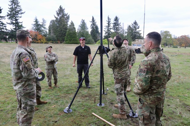 The Joint Base Lewis-McChord team improve antennae reception during exercise Noble Skywave here, Oct. 23, 2019.  A team of 7th Infantry Division Soldiers, 1st Group Special Operations Forces, and airmen from the 22nd Special Tactics Squadron represented JBLM in the competition, testing their abilities against 146 military signal teams from around the world in a series of high-frequency radio challenges while furthering the shared understanding between the service members.  (U.S. Army photo by Sgt. C. Drew Nevitt, 7th Infantry Division)