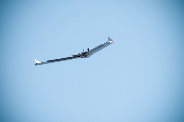 The senseFly eBee X fixed-wing unmanned aircraft system takes to the air just outside the U.S. Army Engineering and Support Center, Huntsville, Ala., during a preliminary survey flight Oct. 1, 2019.