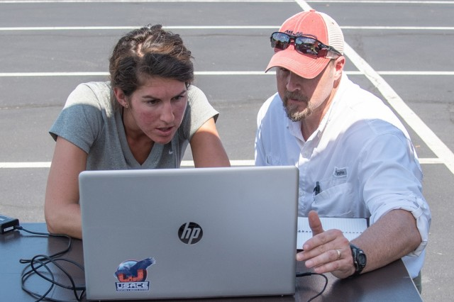 Bethanie Thomas, left, a civil engineer with Huntsville Center's Unmanned Aircraft Systems Site Development Branch, joins Ryan Strange, a research physical scientist with the U.S. Army Corps of Engineers' Aviation and Remote Systems Program and Huntsville Center's UAS Site Development Branch, to ensure an unmanned aircraft is following its prescribed flight plan Oct. 1, 2019, in Huntsville, Ala.