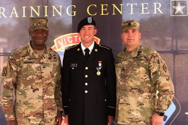 Brig. Gen. Milford H. 'Beags' Beagle Jr., Fort Jackson commander and Post Command Sgt. Maj. Jerimiah C. Gan, pose with Spc. Benjamin Ritchie from 3rd Battalion, 60th Infantry Regiment after his graduation Oct. 24. Ritchie became the third Soldier to max the Army Combat Fitness Test Oct. 21.