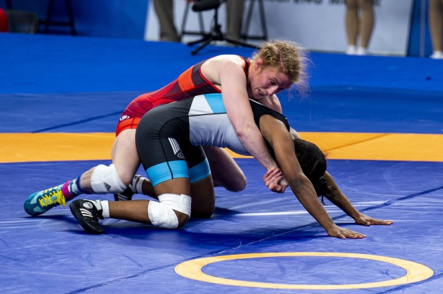 Army Staff Sgt. Whitney Conder with the U.S. Armed Forces Wrestling team competes against Nada Ashour of Egypt in the 50 kg. weight class at the Military World Games in Wuhan, China, Oct. 22, 2019. Conder prevailed 11-0 and earned a silver medal in the games.