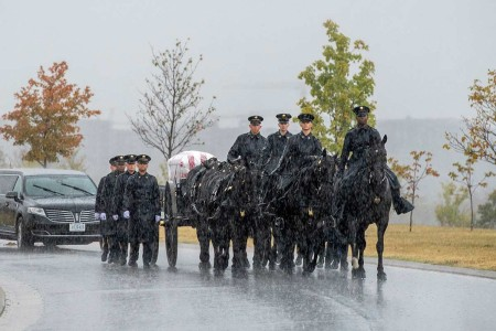 """Soldiers from the 3rd U.S. Infantry Regiment (The Old Guard), the U.S. Army Band, """"Pershing's Own"""", and the 3rd U.S. Infantry Regiment (The Old Guard) Caisson Platoon conduct military funeral honors with funeral escort for U.S. Army Air Force 1st Lt. Seymour Drovis in Section 57 of Arlington National Cemetery, Arlington, Va., Oct. 16, 2019."""
