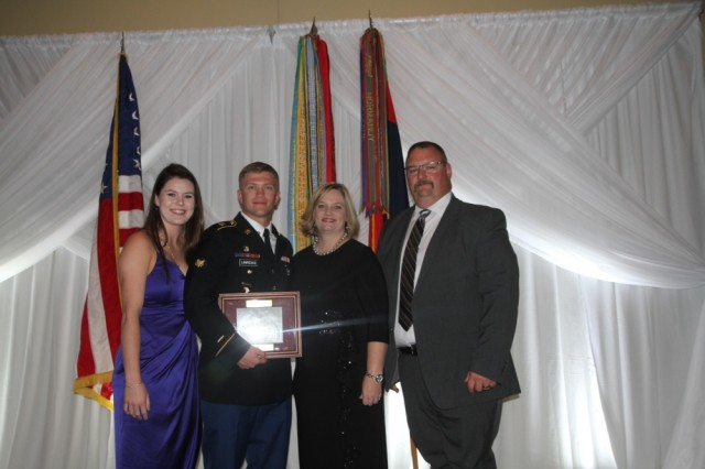 Spc. William Lawrence receives award at the Fort Campbell Chapter - Association of the United States Army Guardian's Gala by Maj. Gen. Brian E. Winski on Oct. 24 for his extraordinary actions taken as a combat medic during Operation Inherent Resolve. Spc. Lawrence stands with his parents at the conclusion of the event. From left Meghan Smith, U.S. Army Spc. William Lawrence, mother Linda Hicks, and stepfather Chris Hicks. The Guardian's Gala is an event that recognizes those who defend, protect and keep. (U.S. Army photo by Maj. Vonnie Wright)
