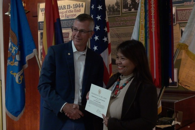 Jeffrey Jennings, Deputy to the Commanding General, U. S. Army Intelligence Center of Excellence (USAICoE) presents a certificate to Liza Soeryanto Wahid, for completing the USAICoE Mentorship Program at a ceremony on Fort Huachuca, Ariz.  (U.S. Army photo by Thom Williams)