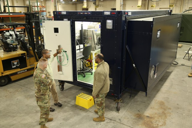 Analytical Laboratory System update under a Modified Work Order to meet Army National Guard readiness needs. Enhancements to the system include a slide-out shelter and additional glovebox.