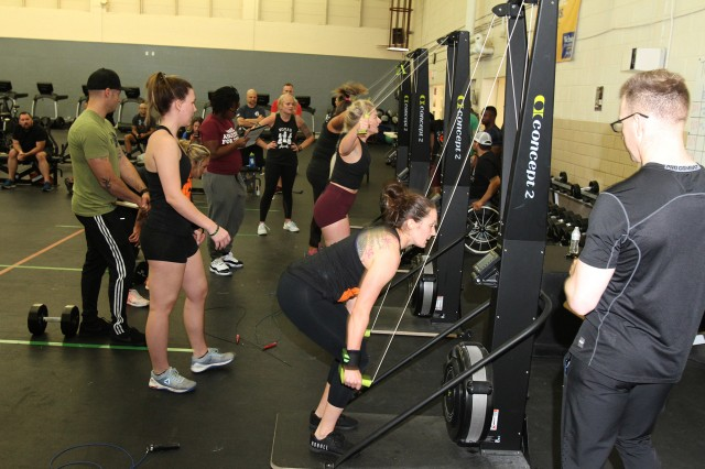 Women competitors finish up their last exercise, a cross-country ski machine, in WOD 4 of the Ghost Thrusters competition at Fort Sill, Oklahoma. Nine women's and 11 men's teams competed and cheered for each other throughout the event.