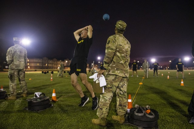 Sgt. Maj. Peter Running, the executive sergeant major to the command sergeant major of the U.S. Army Reserve, throws a medicine ball over his head during the standing power throw for a practice Army Combat Fitness Test (ACFT) at Fort Eustis, Va., Oct. 25, 2019, during the Army Reserve Senior Enlisted Council. The council is a three-day event hosted by Command Sgt. Maj. Ted Copeland, the U.S. Army Reserve's senior enlisted leader. During the workshop the enlisted leaders tackled various topics that affect Soldiers' readiness, training and professional development. They conducted a practice ACFT as they lead the effort to implement the new test over the next 12 months before it becomes the official fitness test of record across the U.S. Army.