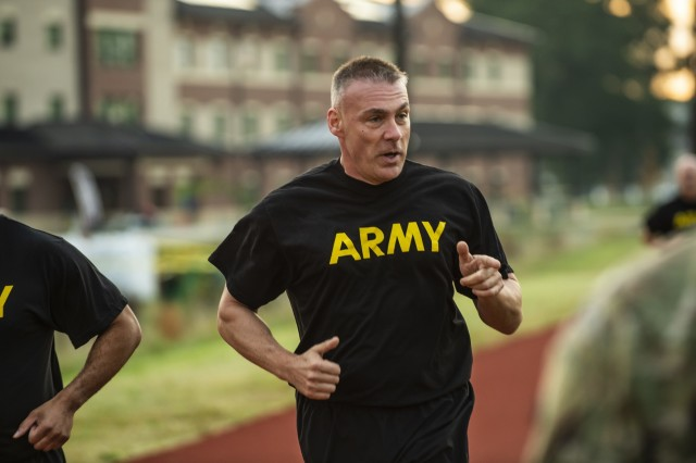 Command Sgt. Maj. Andrew Lombardo, command sergeant major of the 200th Military Police Command, points to his assigned grader during the two-mile run for a practice Army Combat Fitness Test (ACFT) at Fort Eustis, Va., Oct. 25, 2019, during the Army Reserve Senior Enlisted Council. The council is a three-day event hosted by Command Sgt. Maj. Ted Copeland, the U.S. Army Reserve's senior enlisted leader. During the workshop the enlisted leaders tackled various topics that affect Soldiers' readiness, training and professional development. They conducted a practice ACFT as they lead the effort to implement the new test over the next 12 months before it becomes the official fitness test of record across the U.S. Army.