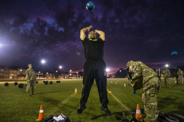 Command Sgt. Maj. Michael Robinson, command sergeant major of the Military Intelligence Readiness Command, throws a medicine ball over his head during the standing power throw event for a practice Army Combat Fitness Test (ACFT) at Fort Eustis, Va., Oct. 25, 2019, during the Army Reserve Senior Enlisted Council. The council is a three-day event hosted by Command Sgt. Maj. Ted Copeland, the U.S. Army Reserve's senior enlisted leader. During the workshop the enlisted leaders tackled various topics that affect Soldiers' readiness, training and professional development. They conducted a practice ACFT as they lead the effort to implement the new test over the next 12 months before it becomes the official fitness test of record across the U.S. Army.
