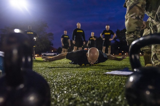 Sgt. Maj. Peter Running, the executive sergeant major to the command sergeant major of the U.S. Army Reserve, performs the hand release push-up for a practice Army Combat Fitness Test (ACFT) at Fort Eustis, Va., Oct. 25, 2019, during the Army Reserve Senior Enlisted Council. The council is a three-day event hosted by Command Sgt. Maj. Ted Copeland, the U.S. Army Reserve's senior enlisted leader. During the workshop the enlisted leaders tackled various topics that affect Soldiers' readiness, training and professional development. They conducted a practice ACFT as they lead the effort to implement the new test over the next 12 months before it becomes the official fitness test of record across the U.S. Army.