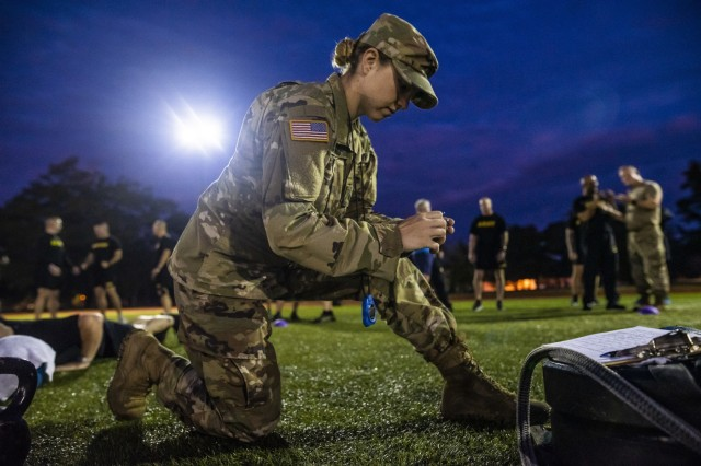 A noncommissioned officer with the Center for Initial Military Training, U.S. Army Training and Doctrine Command, prepares to score the hand release push-up event during a practice Army Combat Fitness Test (ACFT) at Fort Eustis, Va., Oct. 25, 2019, during the Army Reserve Senior Enlisted Council. The council is a three-day event hosted by Command Sgt. Maj. Ted Copeland, the U.S. Army Reserve's senior enlisted leader. During the workshop the enlisted leaders tackled various topics that affect Soldiers' readiness, training and professional development. They conducted a practice ACFT as they lead the effort to implement the new test over the next 12 months before it becomes the official fitness test of record across the U.S. Army.