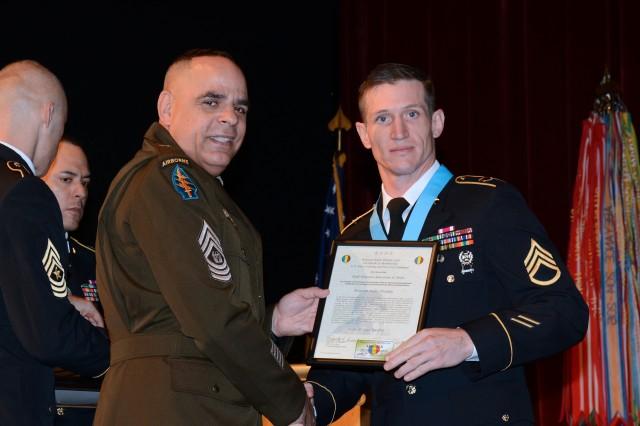 Command Sgt. Maj. Alberto Delgado with Staff Sgt. Alexander H. Bach.