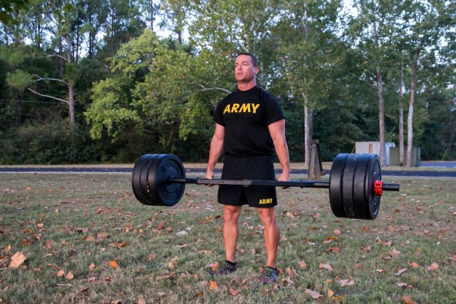 Maj. Bart Brimhall, the deputy Product Manager for Missile Field Development, executes a weight deadlift, one of the six events on the new Army Combat Fitness Test.
