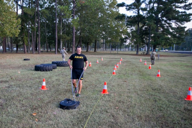 Maj. Bart Brimhall, the deputy Product Manager for Missile Field Development, pulls a 90-pound sled, during the sprint/drag/carry event.