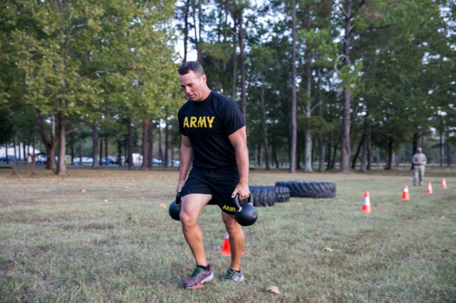 Maj. Bart Brimhall, the deputy Product Manager for Missile Field Development, performs 25-meter dashes carrying 40-pound kettle balls.