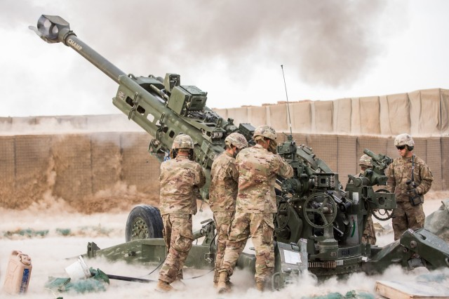 Soldiers assigned to the 1st Brigade Combat Team, 101st Airborne Division, fire a 155mm howitzer from an undisclosed location. With about 2,000 Soldiers deployed across northern Iraq and in parts of Syria, the brigade represented most of Task Force Iraq that oversaw coalition support to Iraqi forces.