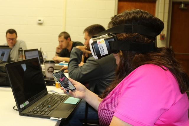 Tonya Combes, a Kansas-area service support specialist Innovation Team member with U.S. Army Corps of Engineers, Tulsa District, tests virtual reality goggles as part of a three-day, multi-district, innovation-themed summit, hosted by the USACE Allatoona Lake Project Office, Cartersville, Ga., Oct. 21-24.