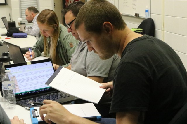 U.S. Army Corps of Engineers Innovation Team members (from right) Alex Stevenson, Ryan Braaten and Nicole Govan conduct research and development for small-group innovation proposals, Oct. 22-24. The summit included more than 20 participants, representing 9 USACE Districts from across the Nation.