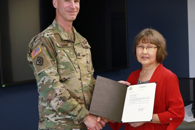 COL. Scott Preston. Commander, Tulsa District, U.S. Army Corps of Engeers presents a letter of appreciation to guest speaker Erendira Zepeda de Williams following Heritage Month celebrations.