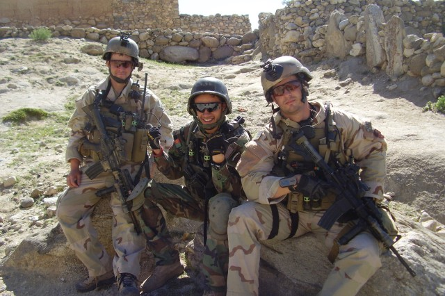 Then-Sgt. Matthew Williams with Staff Sgt. Ronald Shurer II assigned to 3rd Special Forces Group (Airborne), sit outside a small village in Eastern Afghanistan in May 2008.