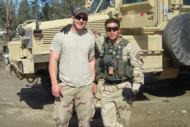 Then-Sgt. Matthew Williams assigned to 3rd Special Forces Group (Airborne), poses with his operational detachment's interpreter in Jalalabad, Afghanistan, spring of 2007.
