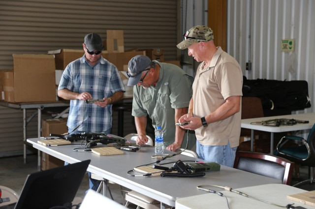 Program Executive Office for Command, Control, Communications --Tactical (PEO C3T) engineers work on software defined radios, during the Integrated Tactical Network (ITN) verification and validation event at the PEO C3T ITN facility on September 11, 2019, at Fort Bragg, North Carolina. The team prepares the expeditionary ITN equipment set for an ITN pilot supported by the 82nd Airborne Division.