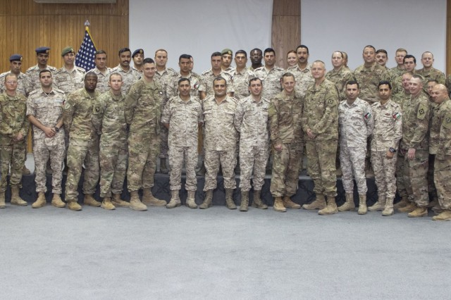 Jordan Armed Forces-Arab Army (JAF) field artillery Soldiers pose alongside U.S. Army Soldiers, with 115th Field Artillery Brigade, Wyoming Army National Guard, after a ceremony that formally commenced the joint training exercise Decisive Spear at Joint Training Center-Jordan October 31, 2019. The U.S. is committed to the security of Jordan and to partnering closely with the JAF to meet common security challenges.