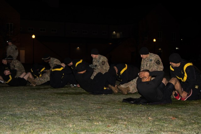 Soldiers from 2nd Stryker Brigade Combat Team, 2nd Infantry Division perform situps during an Expert Infantry Badge physical fitness assessment at Joint Base Lewis-McChord, Oct. 27, 2019. The EIB recognizes Soldiers who have mastered critical tasks in warfighting, demonstrating themselves physically and mentally across 34 separate events.