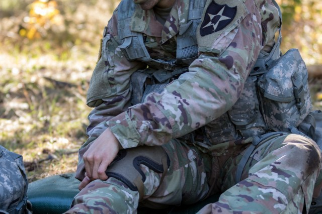 "2nd Lt. Elena Chavez, an infantry officer from Kansas City, Mo., assigned to Charlie Company, 1-17 Infantry Battalion, 2nd Stryker Brigade Combat Team, 2nd Infantry Division, straps on kneepads in preparation for the Expert Infantry Badge move under direct fire lane at Joint Base Lewis-McChord, Washington, Oct. 28, 2019. ""At the end of the day, it's an individual's responsibility to make sure they're ready,"" said Sgt. Tracker Sines, Chavez's squad leader. ""She's doing very well. She has her own system of talking herself through it."""