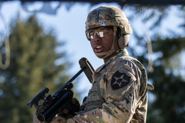 """2nd Lt. Rollin Barton, an engineer officer from Springfield, Ill., assigned to 14th Brigade Engineer Battalion, 2nd Stryker Brigade Combat Team, 2nd Infantry Division, reviews the steps for clearing, loading and firing the M320 grenade launcher module for the Expert Soldier Badge weapons lane at Joint Base Lewis-McChord, Wash., Oct. 29, 2019. """"I came with the mindset that I need to be focused from day one,"""" Barton said. """"Coming out here, rehearsing in my head, and running through it hands-on before I go test is my best bet."""""""