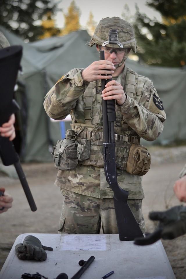 Lancer Soldier assembles shotgun during Expert Soldier and Expert Infantry Badge testing