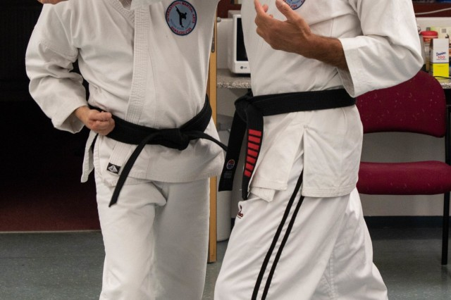 Eddie Guevara, International Martial Arts Self Defense Class Sensei (instructor), and Ed Martin, program coordinator for University of Maryland Global Campus, demonstrate techniques on self defense during a martial arts class held on Katterbach Kaserne, Ansbach, Germany, Oct. 30, 2019. The martial arts class is sponsored by the Post 1982 American Legion in support of the Better Opportunities for Single Soldiers program, to allow Soldiers to improve their self-esteem and boost their confidence, while also improving their ability to defend themselves. (U.S. Army Photo by Pfc. Ashunteia' Smith)