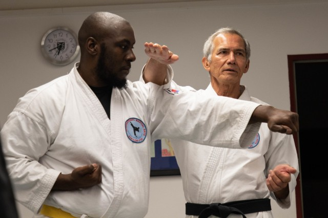 Eddie Guevara, International Martial Arts Self Defense Class Sensei (instructor), and Anthony Riggens, a marketing accountant for the Morale, Welfare, and Recreational Services, demonstrate proper techniques on self defense, during a martial arts class held on Katterbach Kaserne, Ansbach, Germany, Oct. 30, 2019. Guevara has been instructing martial arts classes for over 45 years, and believes this program is a good opportunity for Soldiers to learn how to defend themselves, while also creating lasting friendships. (U.S. Army Photo by Pfc. Ashunteia' Smith)