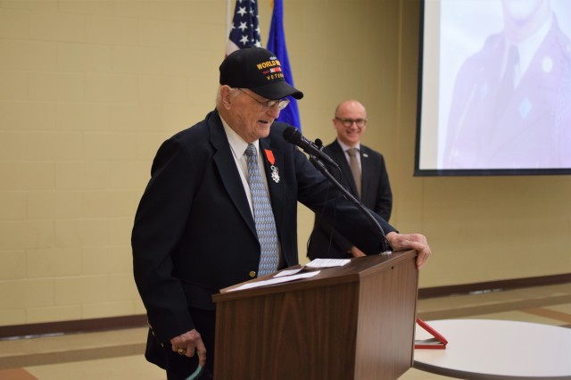 WWII veteran Edward Morrissette shares thoughts with the audience after receiving the French Legion of Honor in a special ceremony Oct. 30, 2019, at the Omaha Army Reserve Center in Elkhorn, Neb. Morrissette served with the 16th Infantry Regiment, 1st Infantry Division, in seven campaigns and multiple beach landings, including Omaha Beach on D-Day June 6, 1944, and was nominated for the award by his family.