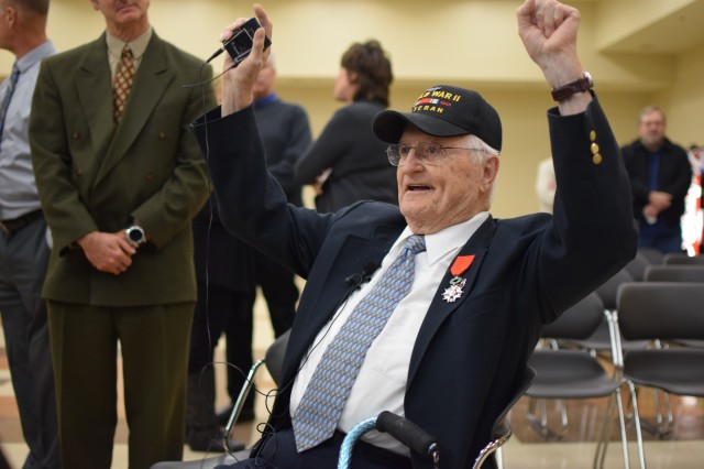 WWII veteran Edward Morrissette tells a story of jumping out of landing craft into chest deep water off Omaha Beach while carrying a rifle and a roll of telephone wire above his head, speaking to reporters Oct. 30, 2019, at the Omaha Army Reserve Center in Elkhorn, Neb. Morrissette served with the 16th Infantry Regiment, 1st Infantry Division, in seven campaigns and multiple beach landings, including Omaha Beach on D-Day June 6, 1944, and was nominated for the award by his family.
