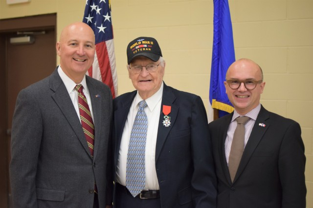Nebraska Governor Pete Ricketts, WWII veteran Edward Morrissette, and French Consul General Guillaume Lacroix gather for a photo after the ceremony in which Morrissette received the French Legion of Honor medal Oct. 30, 2019, at the Omaha Army Reserve Center in Elkhorn, Neb. Morrissette served with the 16th Infantry Regiment, 1st Infantry Division, in seven campaigns and multiple beach landings, including Omaha Beach on D-Day June 6, 1944, and was nominated for the award by his family.