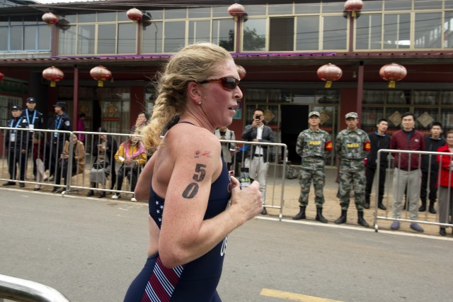 U.S. Air Force Maj. Judith Coyle of the U.S. Armed Forces Triathlon Team runs to win gold in the 2019 CISM Military World Games in Wuhan, China Oct. 26, 2019.