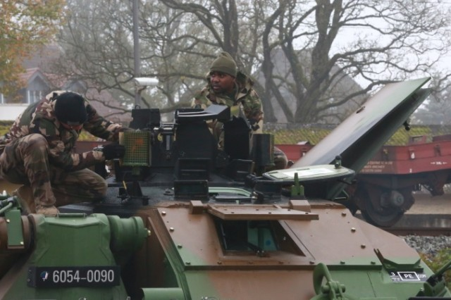 French soldiers of the 501st Main Battle Tank Regiment, Free French 2nd Armoured Division prepare their Leclercs in Parsberg Nov. 1, 2019. They are taking part In the Dragoon Ready exercise at the Joint Multinational Readiness Center in Hohenfels, Germany. Dragoon Ready is a 7th Army Training Command led exercise designed to ensure readiness and certify the 2nd Cavalry Regiment in NATO combat readiness and unified land operations. Working with NATO allies and partners, the 2nd Cavalry Regiment will culminate the exercise with a multinational combined arms live fire and force on force field training exercise. Held annually, Dragoon Ready will incorporate roughly 5,300 multinational Soldiers and over 1,000 pieces of equipment.