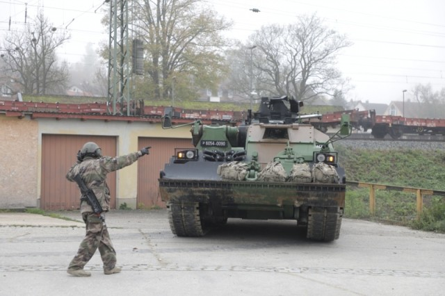 A French soldier of the 501st Main Battle Tank Regiment Free French 2nd Armoured Division directs a Leclercs to be staged for convoy in Parsberg Nov. 1, 2019. They are taking part In the Dragoon Ready exercise at the Joint Multinational Readiness Center in Hohenfels, Germany. Dragoon Ready is a 7th Army Training Command led exercise designed to ensure readiness and certify the 2nd Cavalry Regiment in NATO combat readiness and unified land operations. Working with NATO allies and partners, the 2nd Cavalry Regiment will culminate the exercise with a multinational combined arms live fire and force on force field training exercise. Held annually, Dragoon Ready will incorporate roughly 5,300 multinational Soldiers and over 1,000 pieces of equipment.