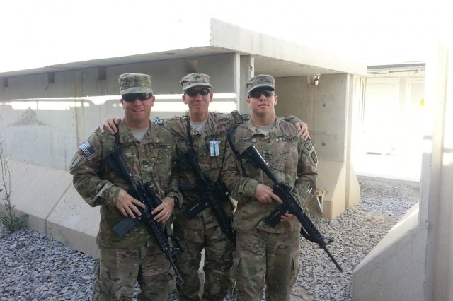 From left to right, Sgt. 1st Class Joseph Howard, Sgt. Michael Howard, motor transport operators, 498th Transportation Company, and Sgt. 1st Class Bryant Howard, motor transport operator, 850th Transportation Company, pose for a photo as Bryant prepares to redeploy back to the U.S. at Kandahar Airfield, April. 28, 2014.