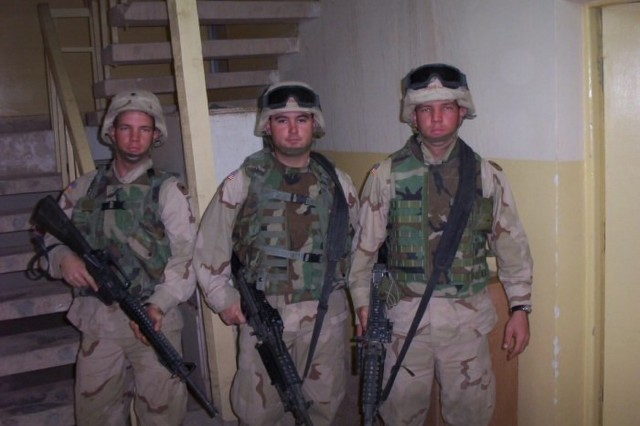 From left to right - Spc. Bryant Howard, Spc. Berry Terrell, and Spc. Joseph Howard, motor transport operators, 498th Transportation Company, stand ready in preparation of a convoy at Camp Speicher, Iraq, Jun. 28, 2003.