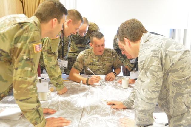 Maj. Michael Kroll, director of the Fort Sill Advanced Education in General Dentistry Residency  Program and deputy consultant to the Army Surgeon General for general dentistry demonstrates staining and glazing techniques to military dentists.