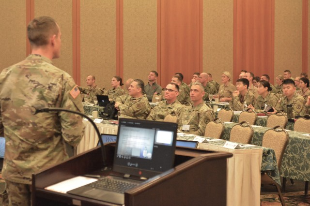 Maj. Michael Kroll discusses the use of CAD/CAM technology at the 62nd Annual U.S. Army Dental Corps European Dental Training Conference held recently in Garmisch, Germany.