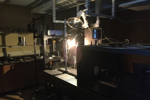 Cadet researchers measure the interaction between a 1-kilowatt high energy laser and a standard steel target.  The research intends to characterize the relationship between hole formation and the angle which the laser beam is incident upon the target.