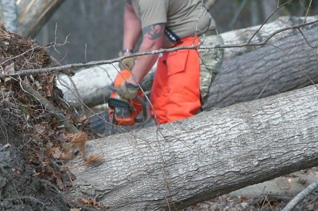 Staff Sgt. Dave Paronett assigned to the 174th Attack Wing, Syracuse, New York operates a chainsaw to clear fallen trees in Herkimer county. This is in response to the New York National Guard activation Gov. Andrew Cuomo initiated on November 1 for damage caused by rain and winds.