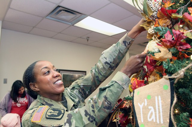Chaplain (Capt.) Kristal McKoy, 3-13th FA, hangs a leaf on the tree of thanks during the Hallelujah Harvest Oct. 31, 2019, at the Frontier Chapel Center. People wrote what they were thankful for and hung it on the tree.